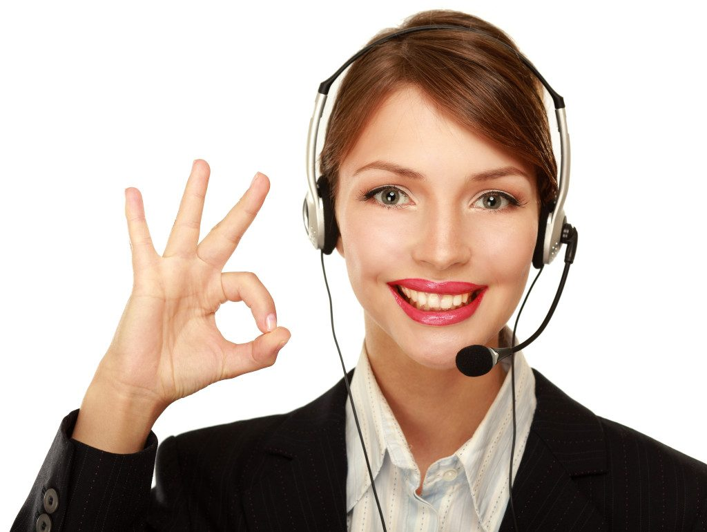 Customer service woman on headset gives OK 1024x770